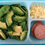 Keto Snack Ideas Container with salad, avocado, spinach, cheese and salami