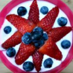 Keto Yoghurt topped with a star of strawberries and blueberries